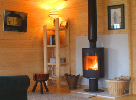 Can I install a stove in a log cabin?