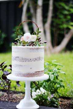 semi naked cake with felt flowers
