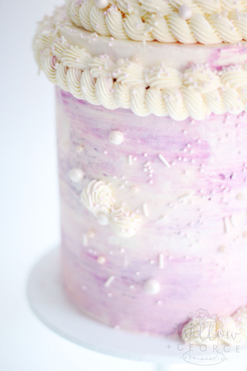 lavender cake with piping