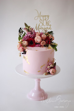 pink birthday with flowers topper