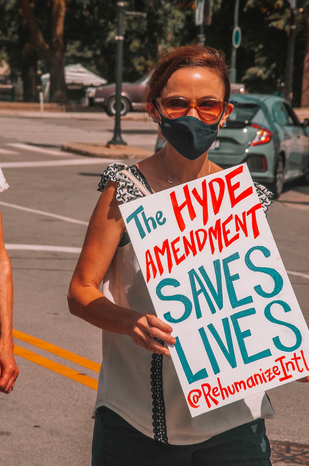 """Person with sign: """"The Hyde Amendment saves lives"""""""