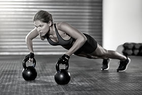 Athletic%20Woman%20With%20Kettlebells_ed