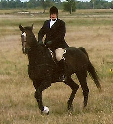 Candy Haasch foxhunting on a thoroughbred rescued from the track.