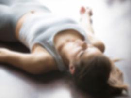 Meditation-woman-lying-on-floor.jpg