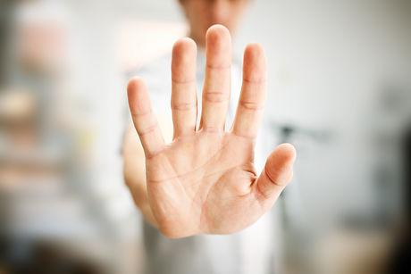 Man showing stop gesture.jpg