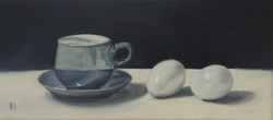 CUP & SAUCER AND TWO EGGS