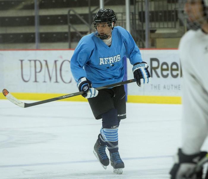Old man playing hockey