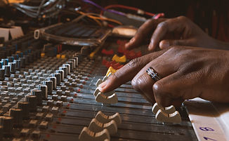 Hands using recording control panel