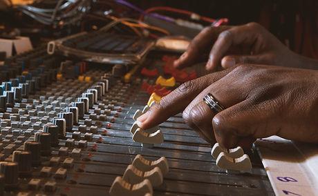 Hands using recording control panel