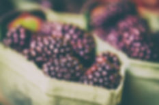 Fresh blackberry at market in paper boxe