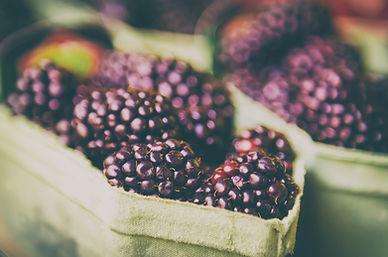 Fresh blackberry at market in paper boxe