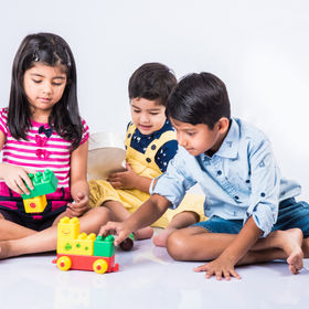 asian kids playing with toys or blocks a