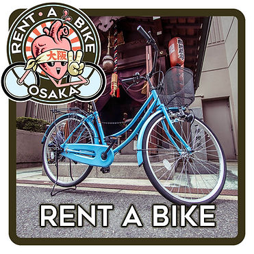 rent a bike Osaka cycle in front of a shrine