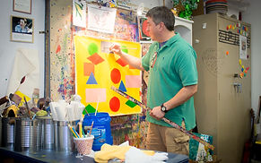 Tennessee residential IDD Services - Man painting colorful shapes