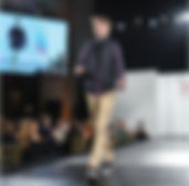 Young man walking runway