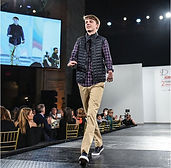 Young man walking runway