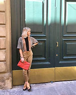 ANDREA BILGRIEN infront of large doors