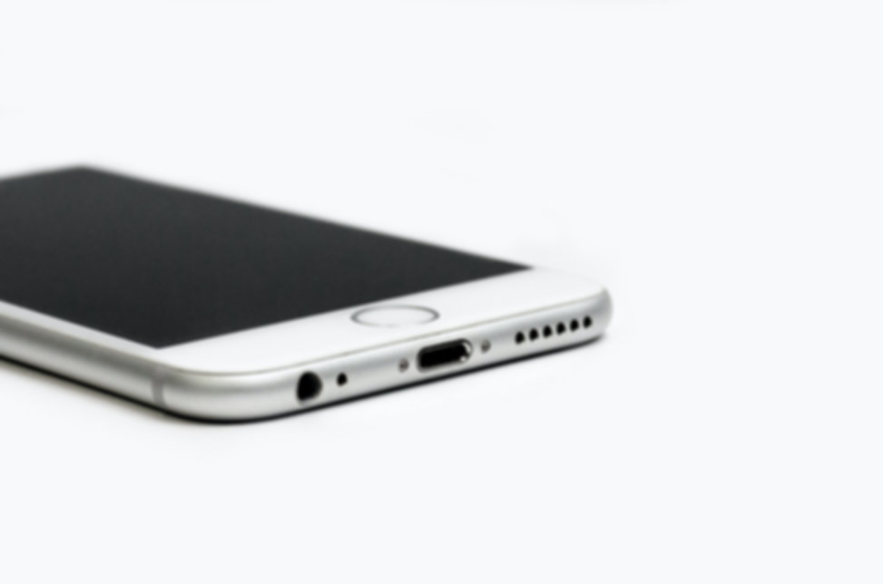 close-up-of-mobile-phone-against-white-b