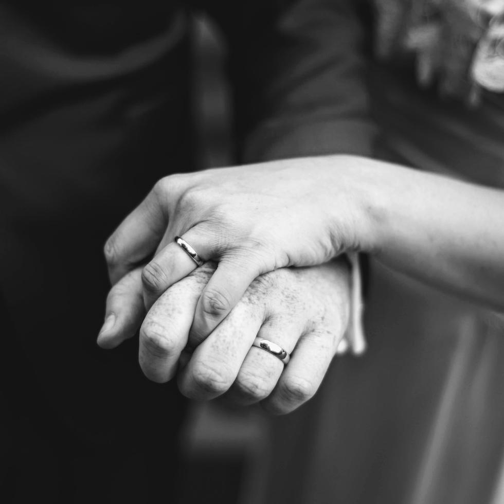 black and white hands showing rings married couple portrait