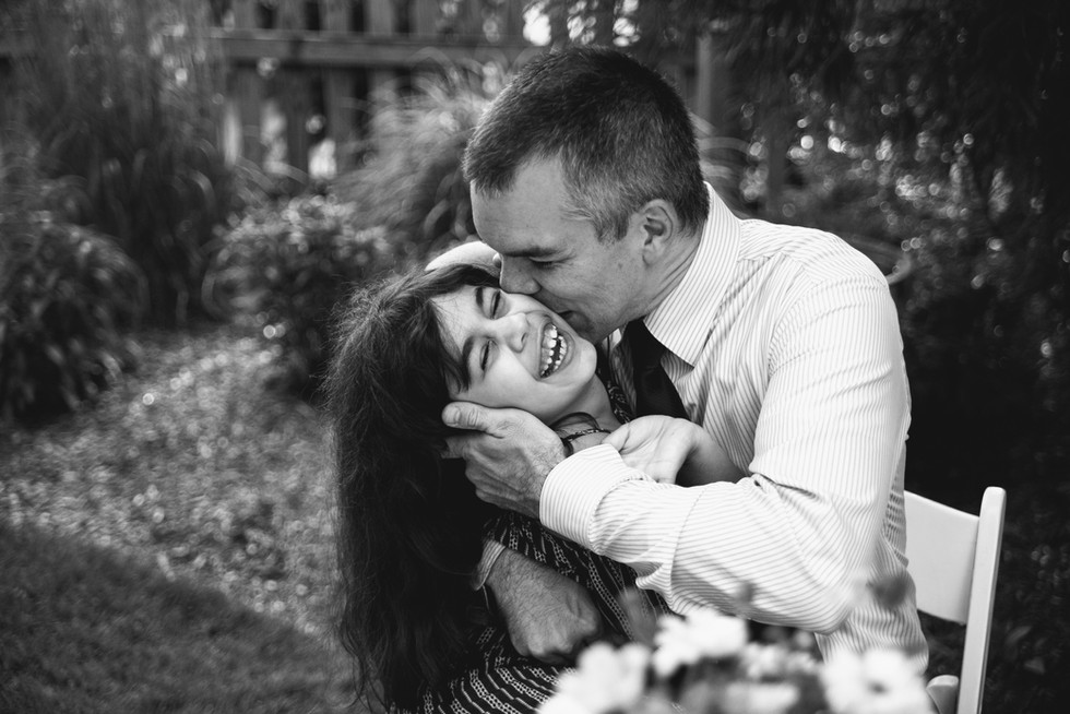 father kisses daughter on cheek in joyous love gesture