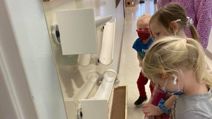 Children playing with a STEM wall