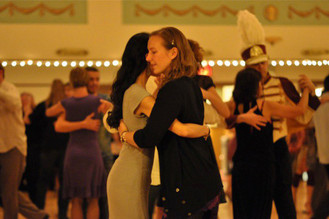 Christa dancing tango with Jennifer Olson