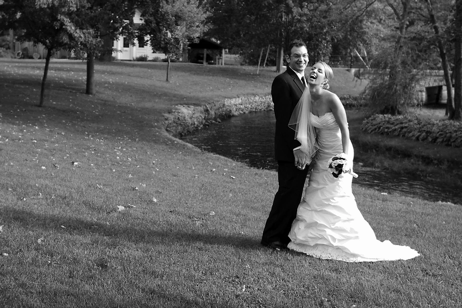 Cathy and Toby, owners of Cat's Cove Communications laughing on their wedding day in Perth, Ontario