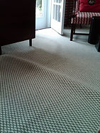 carpet wrinkles before carpet stretching by carpet doctors in richmond va