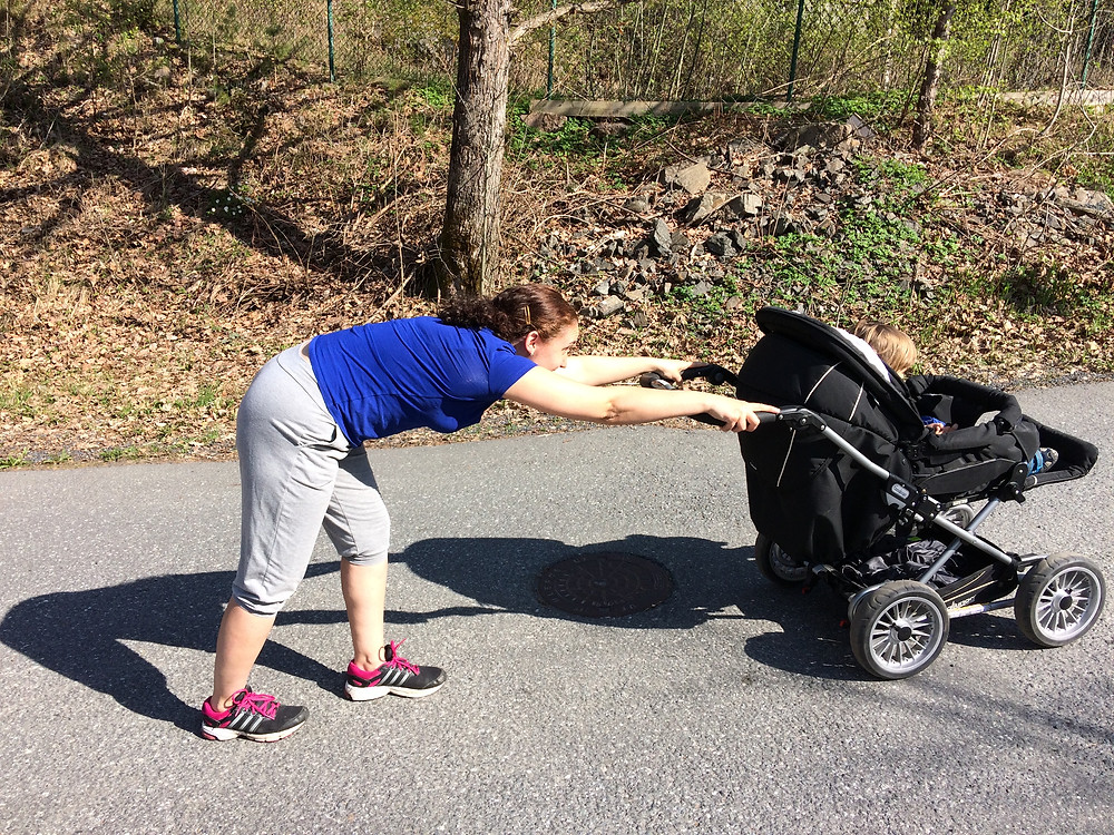 using your back to push the stroller up the hill