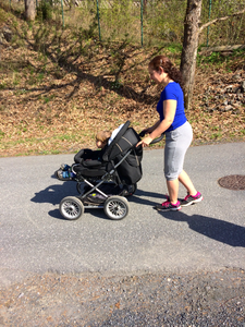 Keeping your body close to the stroller and using your glutes and core to slow it down