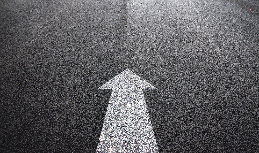 arrow on asphalt
