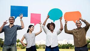 diverse-friends-holding-speech-bubbles.jpg