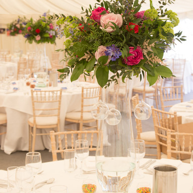 Tall glass table centres