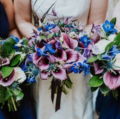 Royal blue and purple bouquets