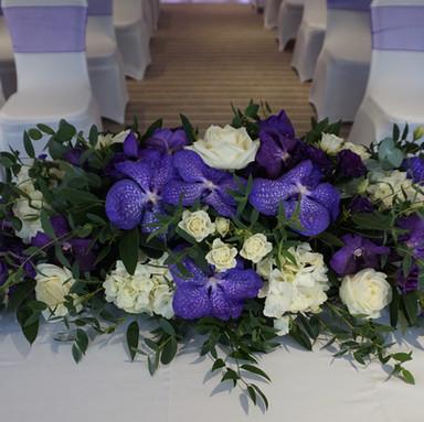 Deep purple orchid top table flowers
