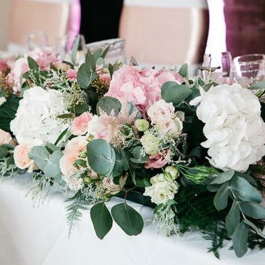 Pastel pink and white top table flowers