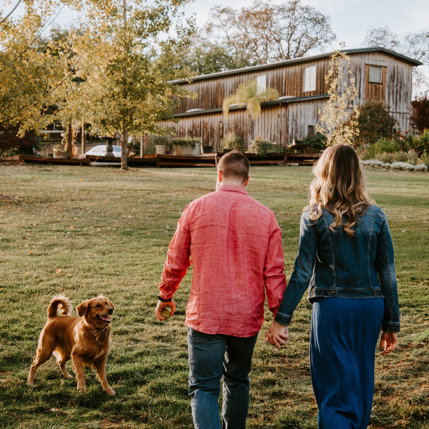 Fun engagement session on a farm with a dog