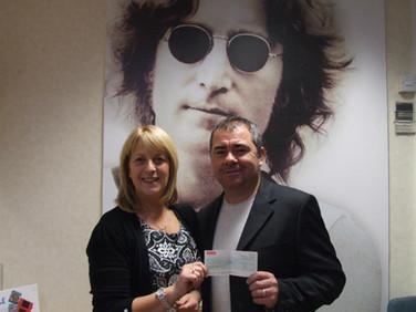 Pete donating to Alder Hey Hospital John Lennon's Imagine Appeal (Liverpool)