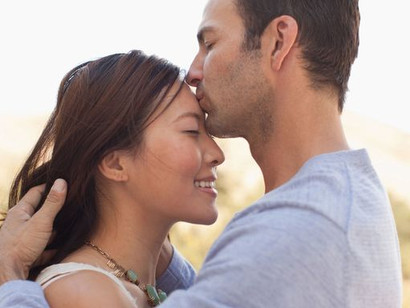 THE FOREHEAD KISS