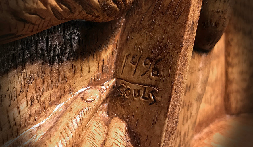 Detail of our full-sized RMS Titanic clock shows the engraving on the tablet that allegorical figure of Honour is holding.