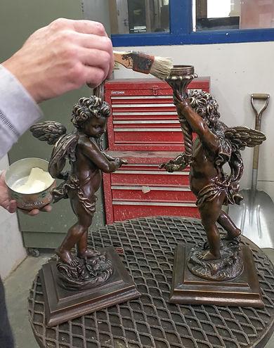 RMS Titanic's small bronze cherub reproductions