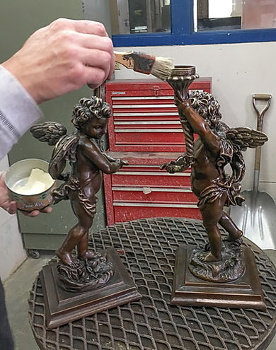 RMS Titanic's small bronze cherub reproductions