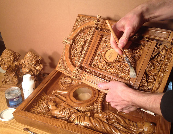 Titanic sculptor Alan St George puts finishing touches on the Grand Staircase replicas in Golden Oak custom color