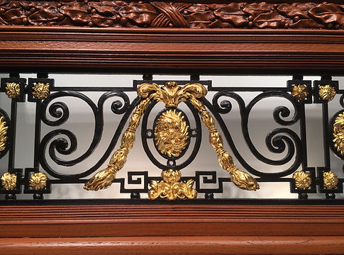Intricately detailed replica of RMS Titanic's balustrade with genuine 24k gold leaf.