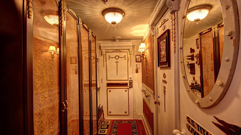 Stephan Asselin's beautiful entrance to his Titanic  Room is a tribute to his skilled hands. A photo of Captain Smith can be seen on the right.