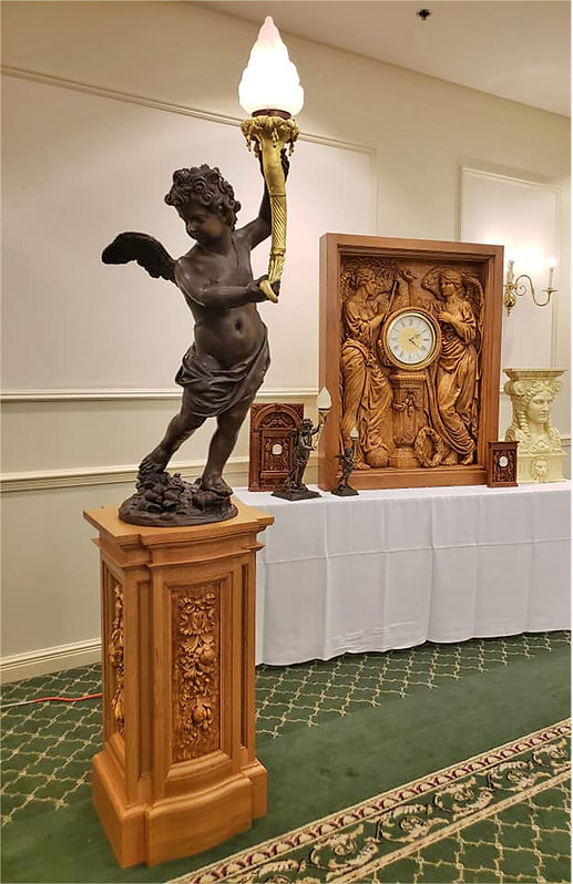 Titanic bronze cherub replica on quarter-sawn white oak pedestal at the Titanic Historical Society Convention in 2018.jpg