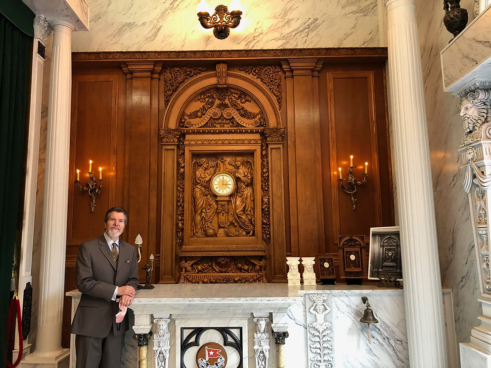Alan St George the Titanic sculptor stands in front of his historically accurate replica of the RMS Titanic full-sized Honour & Glory Crowning Time with full architectural surround
