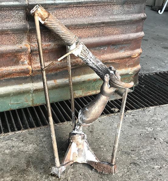The bronze arm and torch of the Titanic cherub lamp.