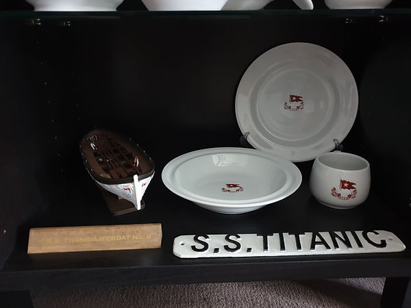 Captain Smith carved in the iceberg sTitanic lifeboat plaque and china from Titanic collector Thomas Lamote of France