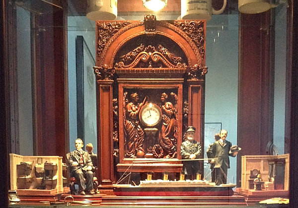 Titanic collection featuring my replica clock surrounded by the ship's Captain Smith and White Star Line miniatures.